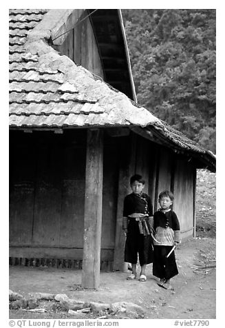 Two Hmong boys outside their house in Xa Linh village. Northwest Vietnam