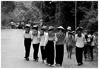 Young thai women walking on the road, between Son La and Tuan Chau. Northwest Vietnam (black and white)