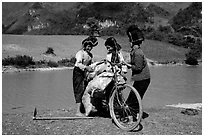 Thai women loading a bicycle, near Tuan Giao. Northwest Vietnam (black and white)