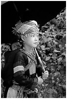 Hmong girl sheltering herself and her younger sibling with an unbrella, between Lai Chau and Tam Duong. Northwest Vietnam (black and white)