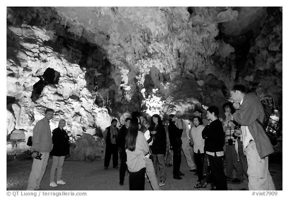 Tourists in illuminated cave. Halong Bay, Vietnam