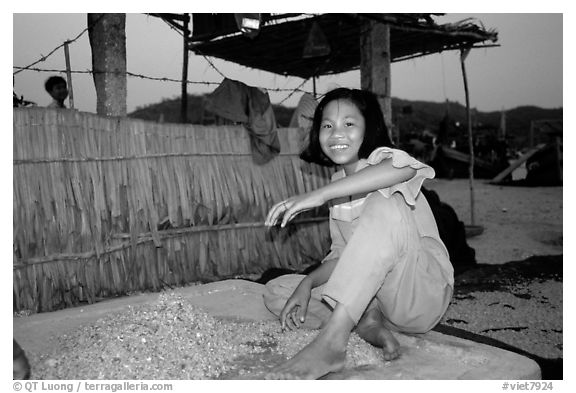 Girl drying shrimp. Ha Tien, Vietnam