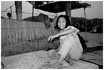 Girl drying shrimp. Ha Tien, Vietnam (black and white)