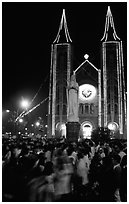 Crowds gather at the Cathedral St Joseph for Christmans. Ho Chi Minh City, Vietnam ( black and white)