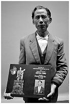 Former militia member with certificate of heroism, Hanoi. Vietnam (black and white)
