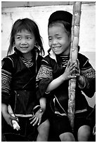 Black Hmong girls, with their daily fix of sugar cane, Sapa. Vietnam (black and white)