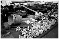 Selling freshly unloaded bananas near the Saigon arroyo. Cholon, Ho Chi Minh City, Vietnam (black and white)
