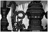 Red color is believed to be lucky. Urn and incense coils, Cho Lon. Cholon, District 5, Ho Chi Minh City, Vietnam ( black and white)