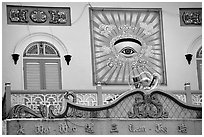 The Cao Dai religion most noteworthy symbol is the all seeing  eye. Tay Ninh, Vietnam (black and white)