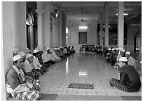 Ceremony in mosque in Cham minority village. Chau Doc, Vietnam (black and white)