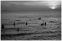 Soaking in the warm China sea at sunset. Vung Tau, Vietnam (black and white)
