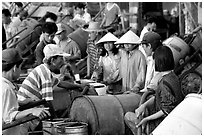 Filling up water tanks for the day. Ha Tien, Vietnam (black and white)