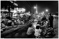 Night market and the local Eiffel tower. Da Lat, Vietnam (black and white)