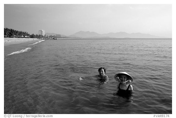 Early morning bath on a perfect beach Nha Trang. Vietnam