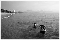 Early morning bath on a perfect beach Nha Trang. Vietnam (black and white)