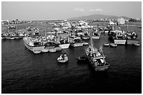 Colorfull fishing boats. Note the circular basket boats used to get to shore.  Nha Trang. Vietnam ( black and white)