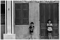 Children in front of old house, Hoi An. Hoi An, Vietnam ( black and white)