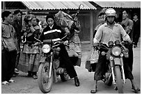 Flower Hmong women getting a ride on all-terrain russian-made motorbikes to the sunday market. Bac Ha, Vietnam (black and white)