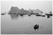 Fishing boat fleet. Halong Bay, Vietnam (black and white)