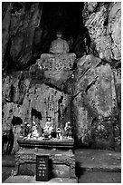 Altar and Buddha statue in a troglodyte sanctuary of the Marble Mountains. Da Nang, Vietnam (black and white)
