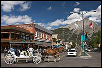 Horse carriage on Banff avenue. Banff National Park, Canadian Rockies, Alberta, Canada
