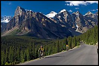 Cyclists on the road to the Valley of Ten Peaks. Banff National Park, Canadian Rockies, Alberta, Canada ( color)