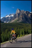 Cyclist on the road to the Valley of Ten Peaks. Banff National Park, Canadian Rockies, Alberta, Canada ( color)