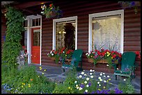Porch of a cabin with flowers. Banff National Park, Canadian Rockies, Alberta, Canada (color)