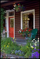 Flowered porch of a wooden cabin. Banff National Park, Canadian Rockies, Alberta, Canada