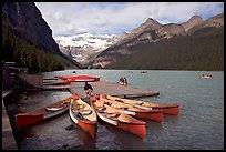 Red canoes at boat dock, Lake Louise, morning. Banff National Park, Canadian Rockies, Alberta, Canada (color)