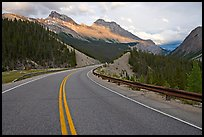 Twisting road, Icefields Parkway, sunset. Banff National Park, Canadian Rockies, Alberta, Canada (color)
