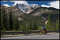 Woman cycling the Icefields Parkway. Jasper National Park, Canadian Rockies, Alberta, Canada