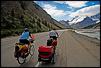 Couple cycling the Icefields Parkway. Jasper National Park, Canadian Rockies, Alberta, Canada