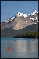 Red canoe on Maligne Lake, afternoon. Jasper National Park, Canadian Rockies, Alberta, Canada