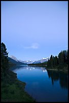 Maligne Lake from the outlet of the Maligne River, blue dusk. Jasper National Park, Canadian Rockies, Alberta, Canada