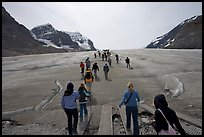 Tourists walking onto  Athabasca Glacier. Jasper National Park, Canadian Rockies, Alberta, Canada