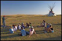 First nations man giving a lecture to students, Head-Smashed-In Buffalo Jump. Alberta, Canada (color)