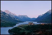 Prince of Wales hotel over Waterton Lakes, dusk. Waterton Lakes National Park, Alberta, Canada ( color)