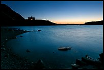Boulders in Waterton Lake and Prince of Wales hotel, dawn. Waterton Lakes National Park, Alberta, Canada ( color)