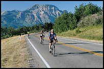 Cyclists on road. Waterton Lakes National Park, Alberta, Canada