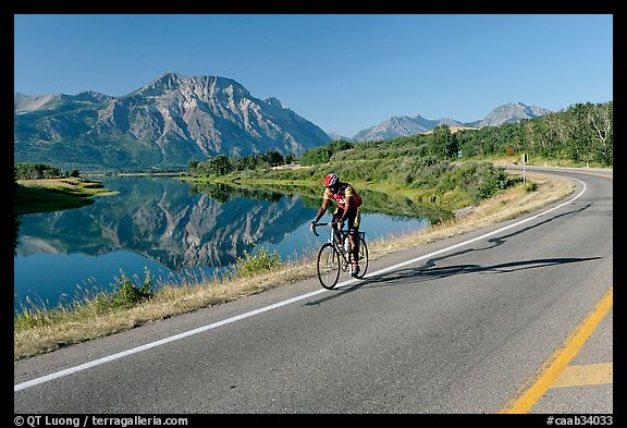 Cyclist next to Lower Waterton Lake. Waterton Lakes National Park, Alberta, Canada