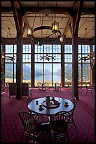 Table in lobby of Prince of Wales hotel with view over Waterton Lake. Waterton Lakes National Park, Alberta, Canada ( color)