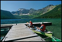 Canoists parking to dock, Cameron Lake. Waterton Lakes National Park, Alberta, Canada (color)