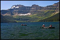 Canoists on Cameron Lake. Waterton Lakes National Park, Alberta, Canada (color)
