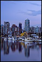Small boat harbor and skyline at dusk. Vancouver, British Columbia, Canada