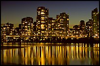 High-rise buildings reflected in False Creek at night. Vancouver, British Columbia, Canada