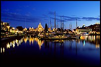 Boats in inner harbour and parliament buildings lights. Victoria, British Columbia, Canada (color)