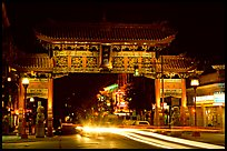 Chinatown gate with trail of lights at night. Victoria, British Columbia, Canada ( color)