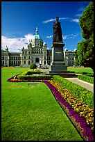 Lawn, statue of Queen Victoria for whom the city was named, and parliament. Victoria, British Columbia, Canada ( color)
