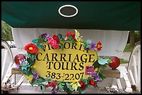 License plate of horse carriage car with flowers. Victoria, British Columbia, Canada